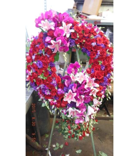 red roses purple lisianthus open wreath