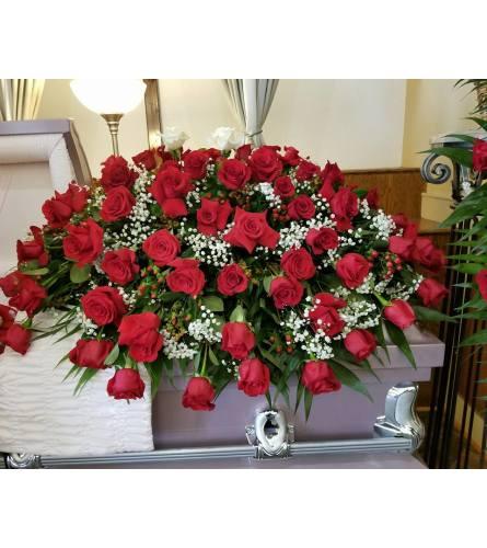 Red roses casket spray
