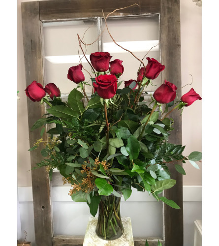 One Dozen Red Roses With Greenery