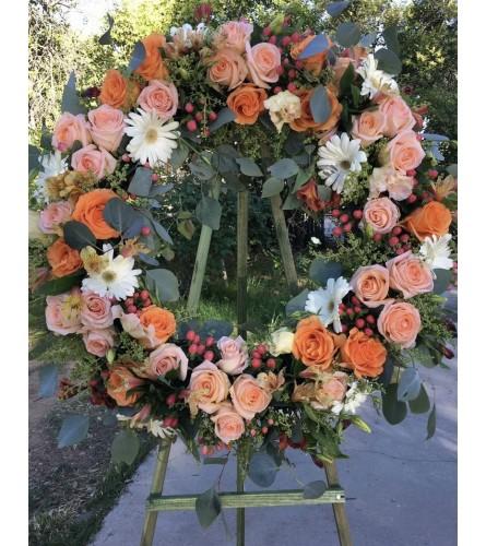 A Sympathy Wreath in Orange/Peace