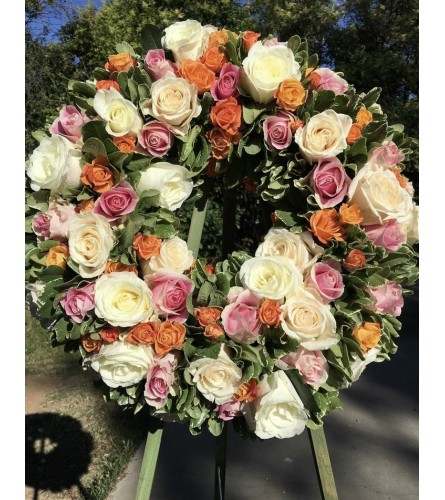 A Sympathy Wreath in All Pastel Roses