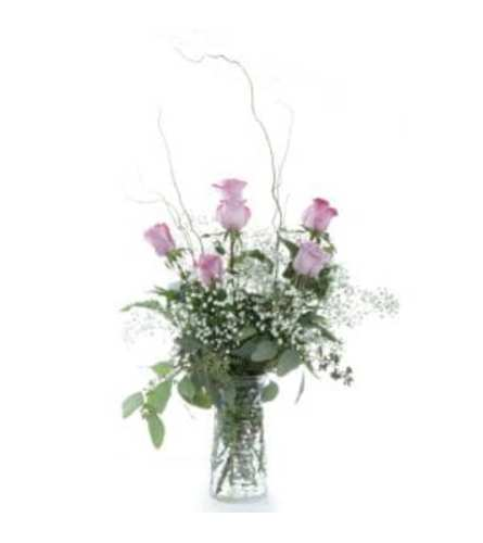 1/2 DOZEN PURPLE ROSES IN VASE WITH GREENS AND FILLER