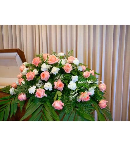 Selfless devotion casket top