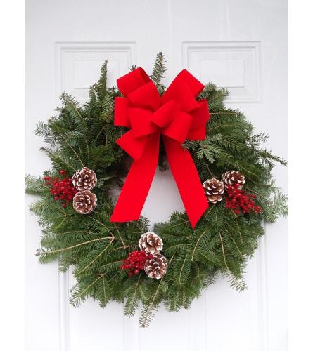 Balsam wreath with red velvet ribbon