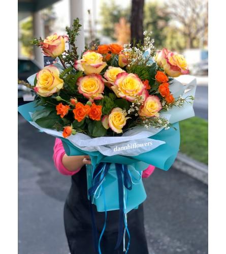 Hot merengue long stem roses and orange mini rose bouquet