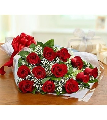DOZEN RED ROSES WRAPPED TO PRESENT AND ARRANGE AT HOME