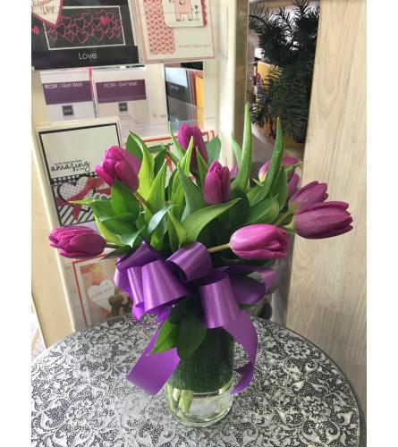 Purple Tulips in clear vase by Vivian