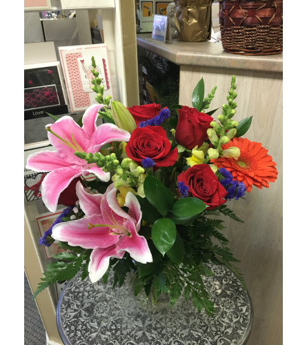 Brighten lovely flowers in vase by Vivian