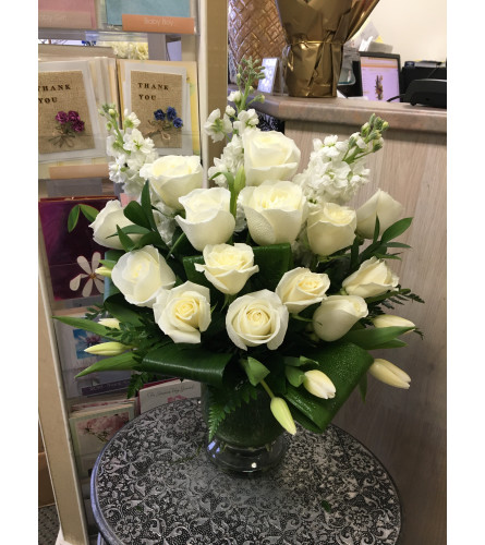 Special white flowers in vase by Vivian