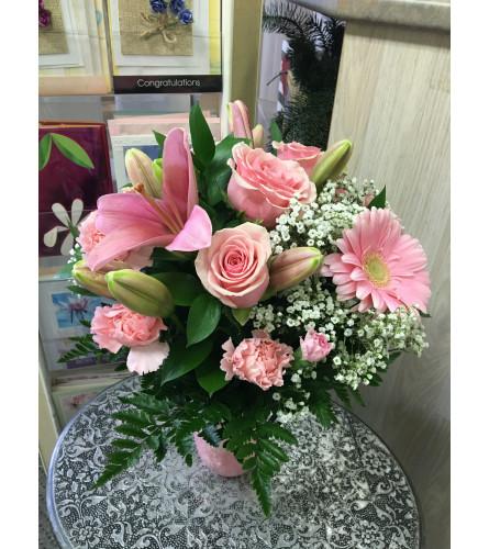 pink flowers in pink vase by Vivian
