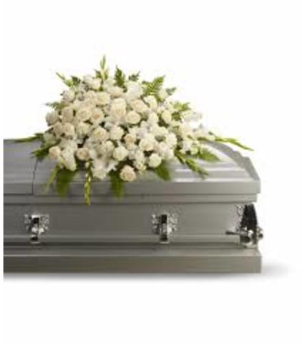 coffin and 10 piece floral arrangement