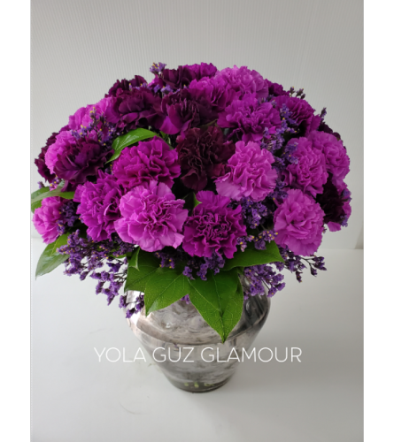 Purple Carnations In a Vase