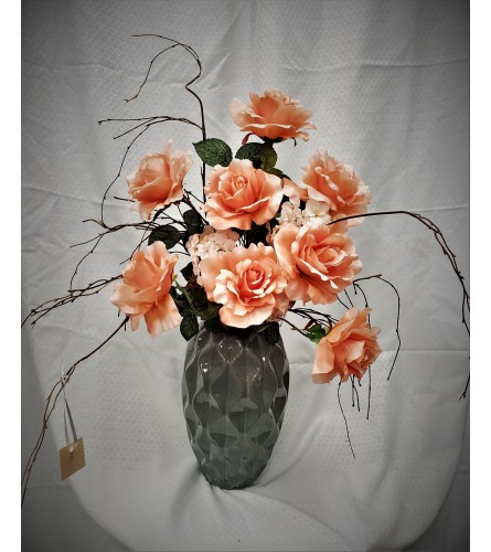 Artificial Orange roses in Grey Urn