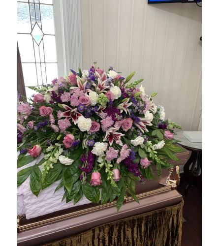 Pastel in Lavender and White Casket Spray