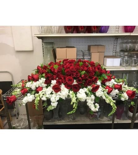 Red top w/white bottom casket spray
