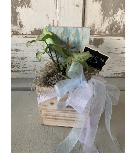 Wooden Box with Green Plant and Cross Sign