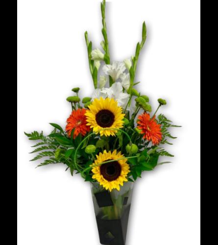 Wide-Eyed Whimsical Floral Arrangement in Premium Polish Vase