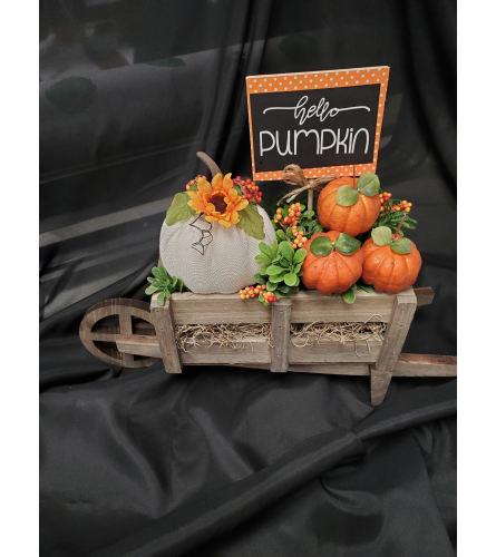 Autumn Wheel Barrow of pumpkins. (Artifical design)