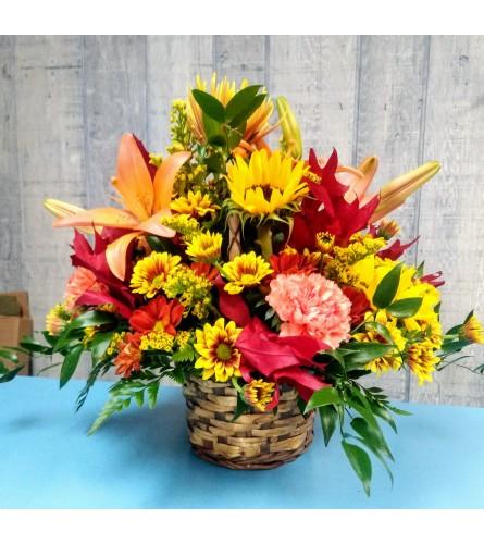 Fall Fresh Arrangement in a brown wicker basket