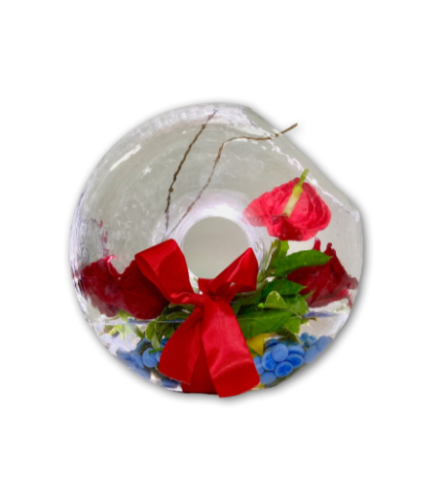 Earth's Gift Arrangement in a Donut Shaped Vase