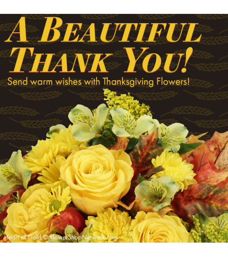Stunning Thanksgiving Day Centerpiece( Florist Choice)