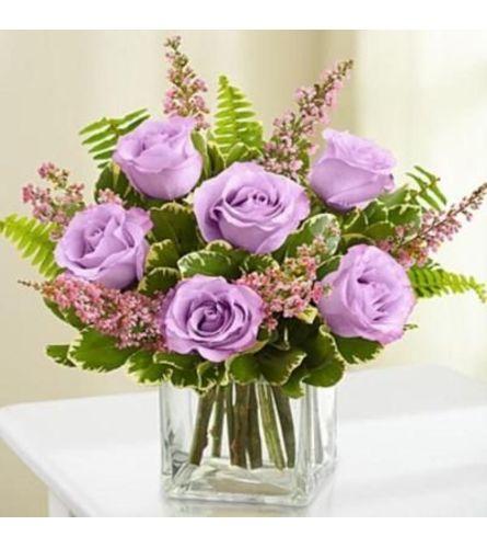 6 Lavender roses in a vase