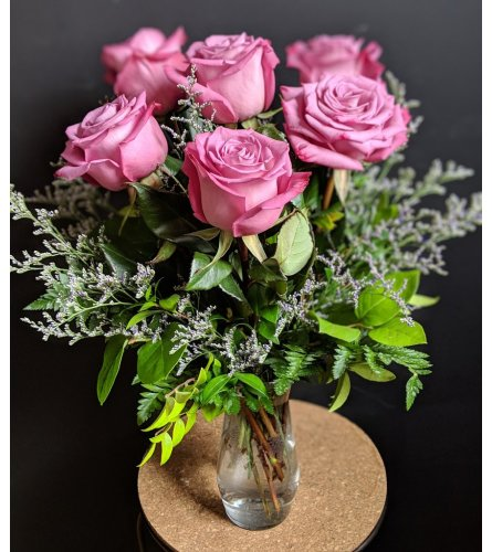 6 Purple roses in a vase