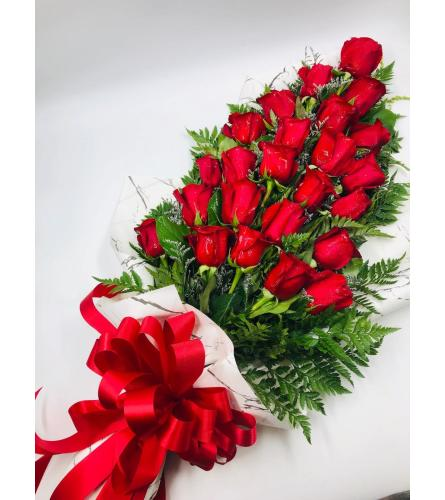 2 DOZEN LOOSE WRAPPED RED ROSES WITH GREENS AND FILLERS