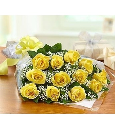 12 YELLOW ROSES LOOSE WRAPPED WITH GREENS AND FILLERS