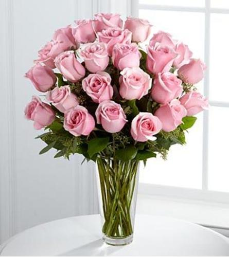 24 LONG STEM PINK ROSES IN A VASE WITH GREENS AND FILLERS