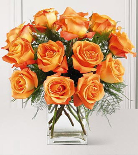 12 LARGE ORANGE ROSES IN A SQUARE VASE WITH GREENS AND FILLERS