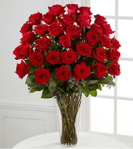 3 DOZEN LONG STEM RED ROSES IN A TALL VASE WITH GREENS AND FILLER