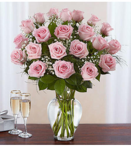 24 Premium long stem pink roses in a vase with greens and fillers