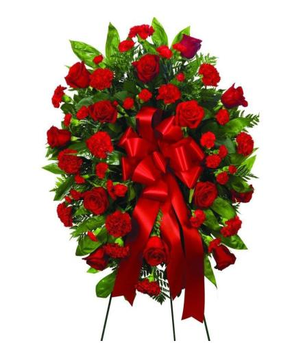 Red roses and red carnation standing spray