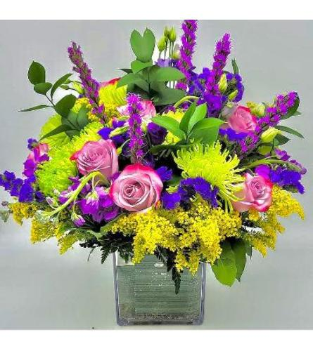 Mixed wild flowers in a square vase