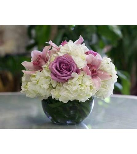 White Hydrangea,Pink Orchids and Lavender Roses in a Glass Fishbo