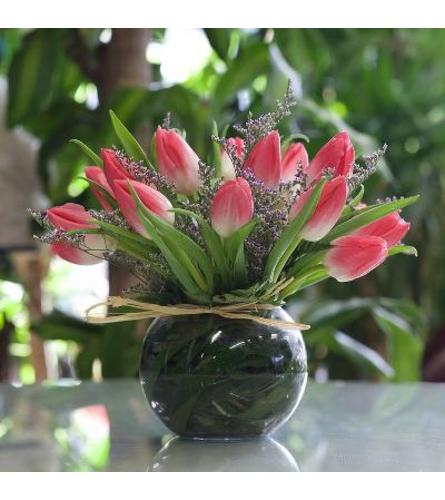 20 Stems pink tulips arranged in a glass fishbowl