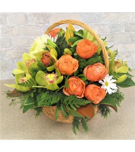 Full basket of roses by O'Flowers