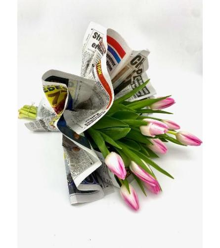 Assorted mixed tulips loose wrapped in news paper