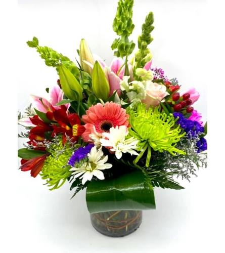 Mixed Bright Wild Flowers In A Cylinder Vase