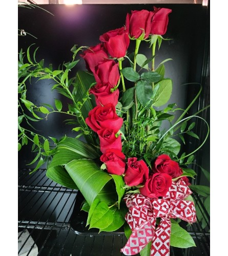 DOZEN RED ROSES IN A STAIRCASE