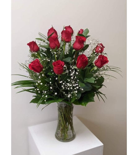 12 Red Roses arranged in a vase.