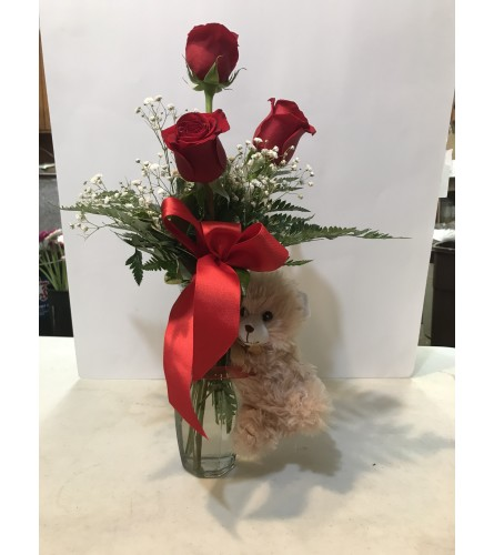 Red roses and small bear