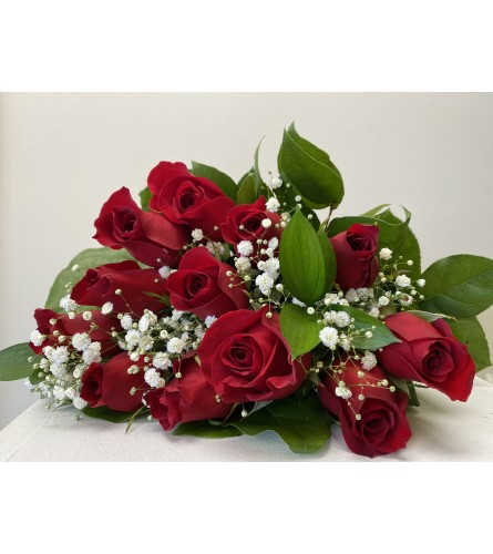 A beautiful dozen red roses wrapped