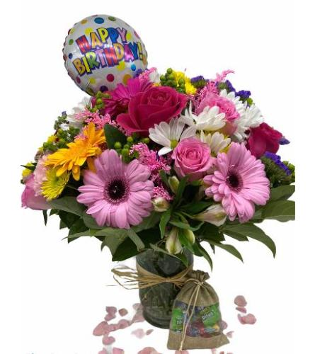 Assorted Pastel Mixed flowers In A Vase With Free Mylar And Candy