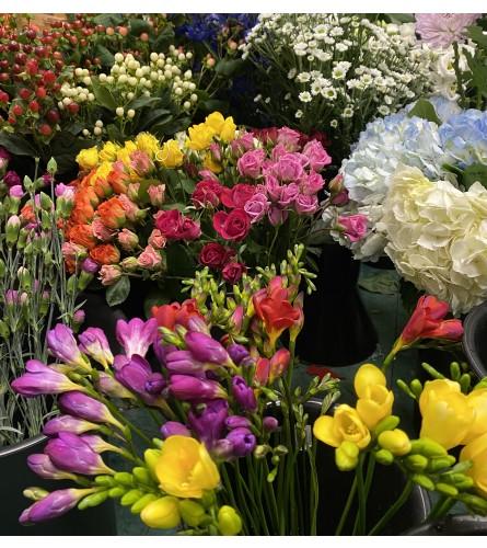 Cut Bouquet. A designers choice of Cut flowers wrapped. *No vase