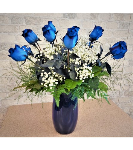 Blue roses in a blue glass vase