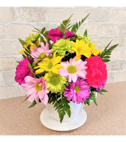 A full cup of bright flowers by O'Flowers
