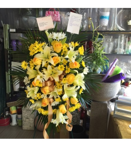 Yellow and White Funeral arrangement