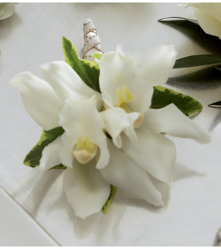 The FTD® White Mini Cymbidium Boutonnier